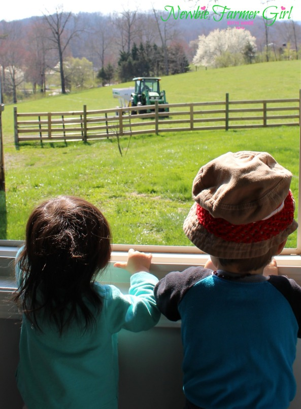 Kye and Kensi looking out window at daddy on tractor